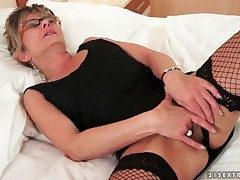 Peerless old lady thither glasses and fishnets masturbates