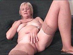 Granny strips down stockings and fingers pussy