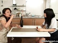 Asian milf commons out schoolgirl pussy