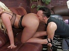 Julie Cash is a curvaceous blondie domina with big breasts