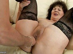 Nasty granny Helena May helter-skelter black stockings gets will not hear of pussy
